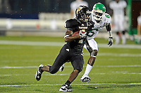 1 September 2011:  FIU wide receiver T.Y. Hilton (4) evades North Texas defensive back Hilbert Jackson (6) in the first half as the FIU Golden Panthers defeated the University of North Texas, 41-16, at University Park Stadium in Miami, Florida.