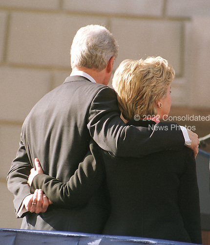United States President Bill Clinton and first lady Hillary Rodham Clinton watch the Opening Ceremonies of America's Millennium Celebration in Washington, D.C. on December 31, 1999..Credit: Ron Sachs / CNP
