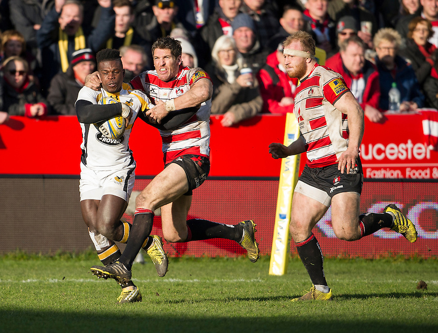 Wasps' Christian Wade evades the tackle of Gloucester Rugby's James Hook to score their opening try<br /> <br /> Photographer Ashley Western/CameraSport<br /> <br /> Rugby Union - Aviva Premiership Round 15 - Gloucester Rugby v Wasps - Saturday 5th March 2016 - Kingsholm Stadium - Gloucester<br /> <br /> &copy; CameraSport - 43 Linden Ave. Countesthorpe. Leicester. England. LE8 5PG - Tel: +44 (0) 116 277 4147 - admin@camerasport.com - www.camerasport.com