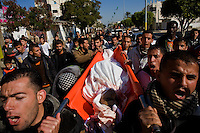 Rafah, Gaza Strip, Jan 12 2009.Street funeral of one of the many civilian victims from the Israeli military operation in Gaza. On the 16th day of the Israeli operation in Gaza, one and a half million people are still deprived of electricity and basic supplies, as well as being unable to flee from the densely populated combat zone.