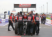 Apr 24, 2015; Baytown, TX, USA; The crew members for NHRA  top fuel driver Leah Pritchett forward to the waterbox during qualifying for the Spring Nationals at Royal Purple Raceway. Mandatory Credit: Mark J. Rebilas-