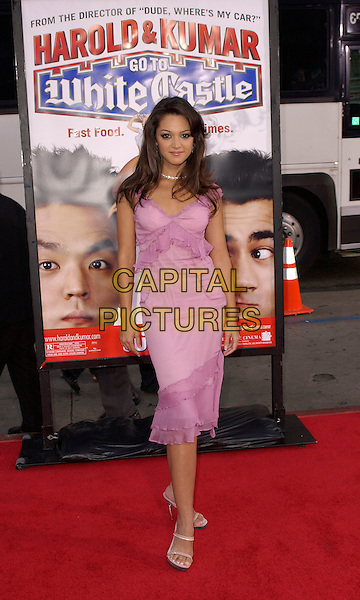 PAULA GARCES.New Line Cinema's World Premiere of 'Harold & Kumar Go to White Castle' held at The Mann's Chinese Village Theatre in Hollywood, California .July 27,2004 .full length, pink dress, layers, chiffon.www.capitalpictures.com.sales@capitalpictures.com.Supplied By Capital Pictures