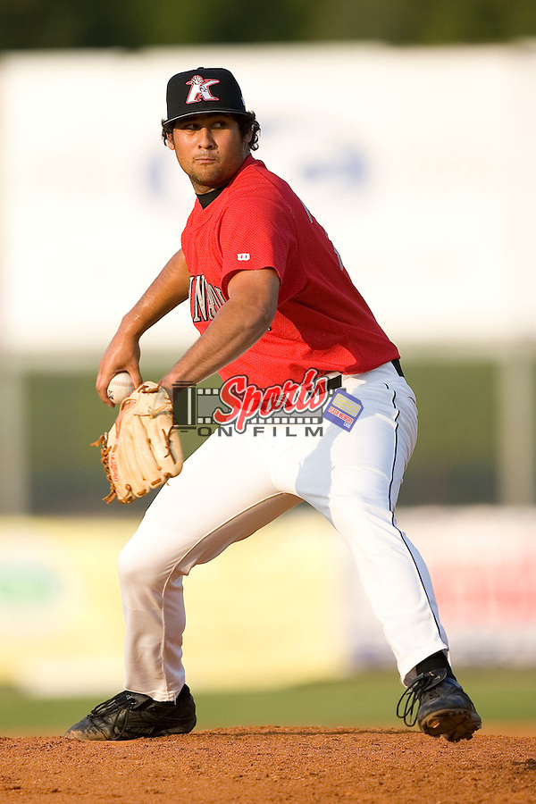 Kannapolis Intimidators relief pitcher Kanekoa Texeira winds up to deliver the ball to the plate versus the Asheville Tourists at Fieldcrest Cannon Stadium in Kannapolis, NC, Monday, August 28, 2006.  The Tourists defeated the Intimidators 7-4 in the first game of a double-header.