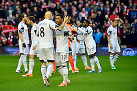 Sunday, 23 February 2014<br /> Pictured: Swansea City players pictured before kick off<br /> Re: Barclay's Premier League, Liverpool FC v Swansea City FC v at Anfield Stadium, Liverpool Merseyside, UK.