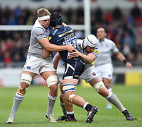 Josh Beaumont of Sale Sharks is double-tackled by Tom Ellis and Dave Attwood of Bath Rugby. Aviva Premiership match, between Sale Sharks and Bath Rugby on May 6, 2017 at the AJ Bell Stadium in Manchester, England. Photo by: Patrick Khachfe / Onside Images