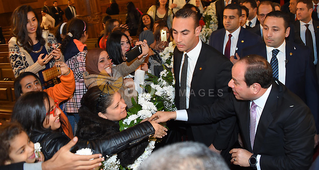 "Egyptian President Abdel Fattah al-Sisi greets faithful at the new Coptic Cathedral ""The Nativity of Christ"", in Cairo, Egypt, January 6, 2018. Photo by Egyptian President Office"