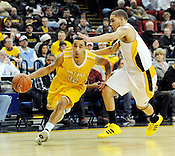 Valparaiso's Brandon Wood drives around Kaylon Williams of the University of Wisconsin Milwaukee during the Horizon League semifinal championship game in Milwaukee, Wis. on Saturday, March 5, 2011. | Ernie Mastroianni~For Sun-Times Media