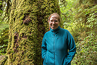 Lori stands in front of a moss-covered tree on the Rain Forest Nature Trail in the Quinault Rain Forest on July 20, 2016. The termperate rain forest areas on the Olympic Peninsula get upwards of 200 inches of rain per year, making it very lush, moss-covered, and green.