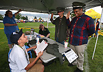 James Pierott, 13, with the Stellar Squad, left, gives the oath of office to Troy Diaz, 15, left, and Jonathan Thomas, 17, at the 11th annual National Night Out hosted by the Carson City Sheriff's Office in Carson City, Nev., on Tuesday, Aug. 6, 2013. <br /> Photo by Cathleen Allison