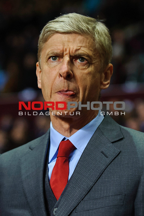 Arsenal Manager Arsene Wenger (FRA) sticks his tongue out as he stands in the dugout before the match -  - 13/01/2014 - SPORT - FOOTBALL - Villa Park, Birmingham - Aston Villa v Arsenal  - Barclays Premier League.<br /> Foto nph / Meredith<br /> <br /> ***** OUT OF UK *****