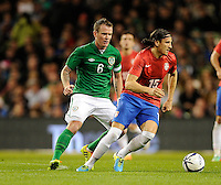 5th March 2014; Ljubomir Fejsa, Serbia, in action against Glenn Whelan, Ireland. International Friendly, Republic of Ireland v Serbia, Aviva Stadium, Dublin. Picture credit: Tommy Grealy / actionshots.ie
