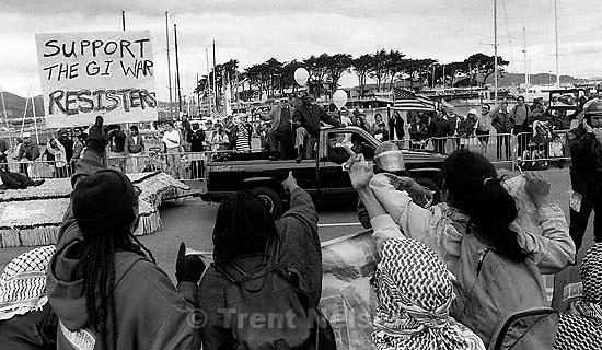 Man flips off floats at Gulf War celebration parade.<br />