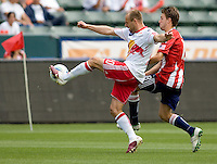 NY RedBulls midfielder Joel Lindpere (20) battles Chivas USA midfielder Blair Gavin (18). Chivas USA defeated the Red Bulls of New York 2-0 at Home Depot Center stadium in Carson, California April 10, 2010.  .