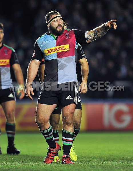 Joe Marler of Harlequins issues instructions. European Rugby Champions Cup match, between Harlequins and Wasps on January 17, 2015 at the Twickenham Stoop in London, England. Photo by: Patrick Khachfe / JMP