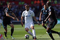 Fernando Llorente of Swansea City (C)  is closely marked by Jonny Evans (L) and Craig Dawson (R) of West Bromwich Albion during the Premier League match between Swansea City and West Bromwich Albion at The Liberty Stadium, Swansea, Wales, UK. Sunday 21 May 2017