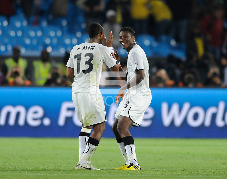 Asamoah Gyan of Ghana celebrates victory with a dance