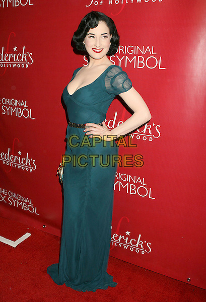 DITA VON TEESE.Frederick's of Hollywood Fashion Show held at the Hollywood Palladium, Hollywood, California, USA..October 24th, 2007.full length blue teal green cleavage red lipstick hand on hip gold belt .CAP/ADM/RE.©Russ Elliot/AdMedia/Capital Pictures.