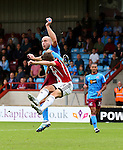 David Mirfin of Scunthorpe Utd fouls Stefan Scougall of Sheffield Utd to give away a penalty during the English League One match at Glanford Park Stadium, Scunthorpe. Picture date: September 24th, 2016. Pic Simon Bellis/Sportimage