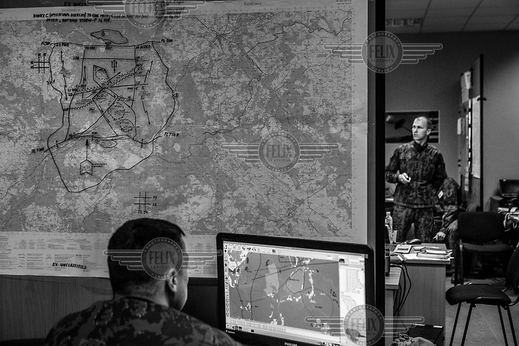 Captain Kosinkas, from the Lithuanian army, in the situation room during NATO Iron Sword joint exercises.