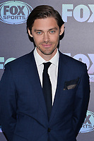 NEW YORK - MAY 13: Tom Payne attends the Fox 2019 Upfront Red Carpet arrivals at the Wollman Rink in Central Park on May 13, 2019 in New York City. (Photo by Anthony Behar/Fox/PictureGroup)
