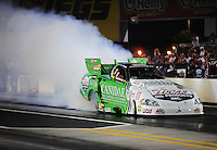 Sept. 17, 2010; Concord, NC, USA; NHRA funny car driver Paul Lee does a burnout during qualifying for the O'Reilly Auto Parts NHRA Nationals at zMax Dragway. Mandatory Credit: Mark J. Rebilas/