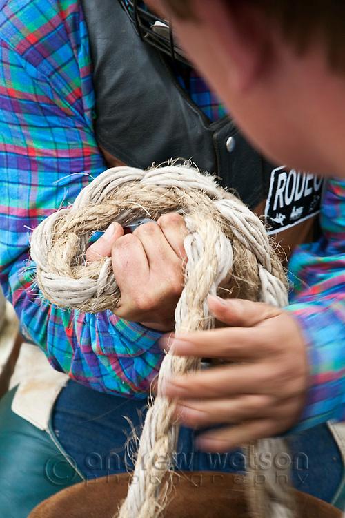 Bull rider grips his ropes.   Mareeba Rodeo, Mareeba, Queensland, Australia
