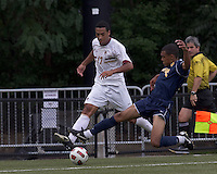 Boston College forward Charlie Rugg (17) crosses the ball as Quinnipiac University defender Brandon Strain-Goode (2) defends. Boston College defeated Quinnipiac, 5-0, at Newton Soccer Field, September 1, 2011.