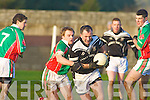 Class Acts: Kilcummin full back Ronan O'Connor tries to rip the ball from Ardfert's Stephen Wallace in their County League Division One relegation play-off.
