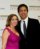 Ray Romano and his wife, Anna, arrive for the formal Artist's Dinner honoring the recipients of the 2012 Kennedy Center Honors hosted by United States Secretary of State Hillary Rodham Clinton at the U.S. Department of State in Washington, D.C. on Saturday, December 1, 2012. The 2012 honorees are Buddy Guy, actor Dustin Hoffman, late-night host David Letterman, dancer Natalia Makarova, and the British rock band Led Zeppelin (Robert Plant, Jimmy Page, and John Paul Jones)..Credit: Ron Sachs / CNP