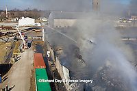 63818-02314 Firefighters extinguishing warehouse fire using aerial ladder truck viewed from top of ladder, Salem, IL