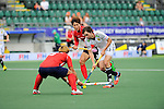 The Hague, Netherlands, June 10: Tobias Hauke #13 of Germany dribbles the ball during the field hockey group match (Men - Group B) between Germany and Korea on June 10, 2014 during the World Cup 2014 at Kyocera Stadium in The Hague, Netherlands. Final score 6-1 (3-0) (Photo by Dirk Markgraf / www.265-images.com) *** Local caption *** Tobias Hauke #13 of Germany, Daekeun Oh #5 of Korea, Byungjin Jeon #27 of Korea