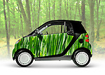 Green fuel efficient city mini car. 2008 Smart Fortwo. Isolated with clipping path on green nature background.