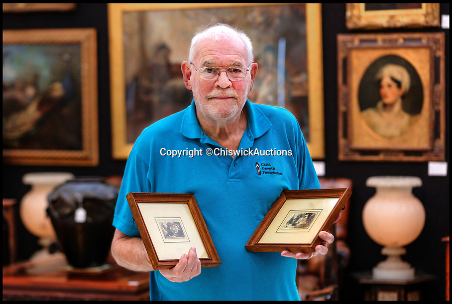 BNPS.co.uk (01202 558833)<br /> Pic:  ChiswickAuctions/BNPS<br /> <br /> Tam Fry with two of the drawings by artist John Constable.<br /> <br /> Two previously unknown drawings by English artist John Constable that hung above a connoisseurs's bed for 50 years have sold for £115,000.<br /> <br /> The small sketches of a woodland glade belonged to the late playwright Christopher Fry and were found by his son Tam while clearing out his father's home.<br /> <br /> Mr Fry Snr placed the two pen and ink drawings on his bedroom wall after acquiring them in the 1950s.<br /> <br /> After his death in 2005 aged 97, the drawings were placed in a cardboard box and left in a spare room.<br /> <br /> Tam Fry, a retired BBC TV director, did not realise who the artist was at first until his daughter spotted the name John Constable RA inscribed on the mounts.
