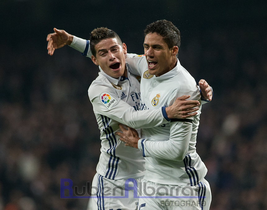 Real Madrid's French defense Raphael Varane and Colombian midfielder James Rodriguez celebrating after scoring during the Copa del Rey soccer match between Real Madrid and Sevilla played at the Santiago Bernabéu stadium in Madrid, on January 4th 2017.
