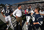 Mason Kamerer joins Gov. Brian Sandoval, center, and Nevada's Cody Fajardo and Jack Reynoso on the field before an NCAA college football game against UNLV, in Reno, Nev., on Saturday, Oct. 26, 2013.<br />