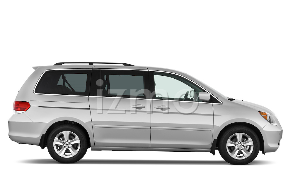 Passenger side profile view of a 2009 Honda Odyssey Touring.