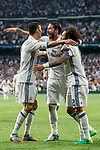 Cristiano Ronaldo (l) of Real Madrid celebrates with teammates Sergio Ramos (c) and Marcelo Vieira Da Silva during their 2016-17 UEFA Champions League Quarter-finals second leg match between Real Madrid and FC Bayern Munich at the Estadio Santiago Bernabeu on 18 April 2017 in Madrid, Spain. Photo by Diego Gonzalez Souto / Power Sport Images