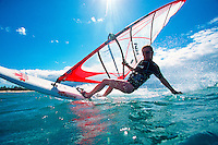 Windsurfer (Model Released) off the coast of Maui, Hawaii, USA.