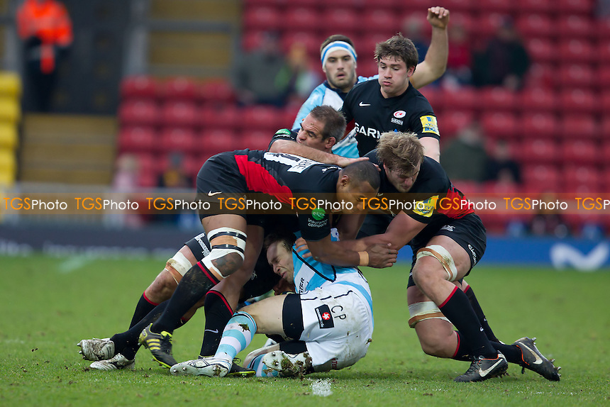 Chris Pennell (c) of Worcester Warriors RFC is ambushed by the Saracens defensive unit - Saracens RFC vs Worcester Warriors RFC - LV Cup 3rd Round Rugby at Vicarage Road Stadium, Watford FC - 29/01/12 - MANDATORY CREDIT: Ray Lawrence/TGSPHOTO - Self billing applies where appropriate - 0845 094 6026 - contact@tgsphoto.co.uk - NO UNPAID USE.