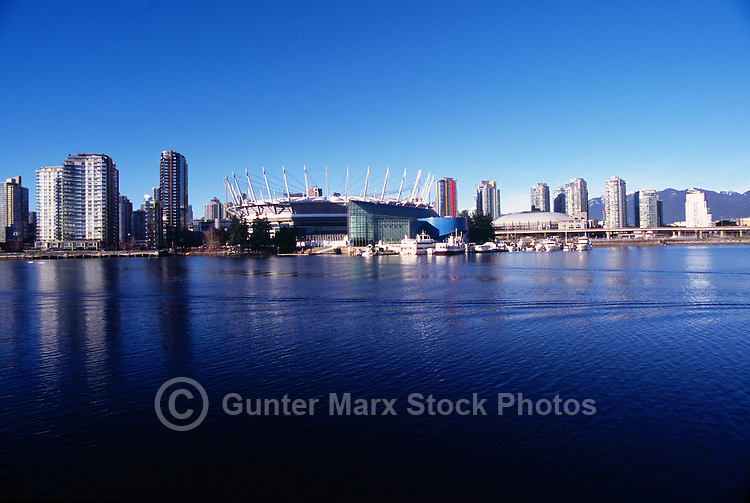 City of Vancouver Skyline, BC, British Columbia, Canada - BC Place Stadium (New Retractable Roof completed in 2011), and Residential High Rise Condominium Buildings at False Creek