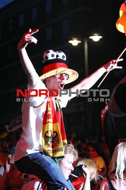 UEFA Euro 2008 1/2 Finale Fanmeile Bremen Match 29 <br /> Halffinal - Halbfinale<br /> Deutschland (GER) - TŁrkei (TUR) 3:2 (1:1)<br /> Germany vs. Turkey<br /> <br /> Fanmeile und Public Viewing in Bremen.<br /> &lsaquo;berschwengliches feiern eines Fans nach dem Sieg der deutschen Mannschaft und dem Einzug ins Finale der EM.<br /> <br /> Foto &copy; nph (  nordphoto  ) *** Local Caption ***