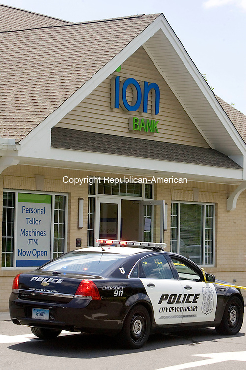 WATERBURY CT. 10 July 2015-071015SV03-Waterbury Police investigate a reported robbery of the Ion Bank at 3670 East Main Street in Waterbury Friday.<br /> Steven Valenti Republican-American