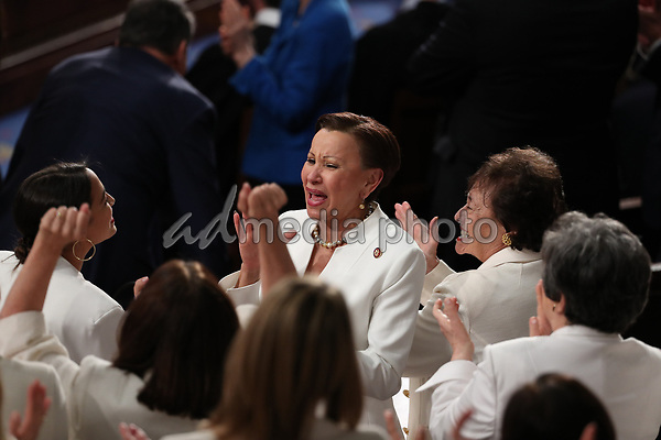 United States Representative Alexandria Ocasio-Cortez (Democrat of New York), left, US Representative Nydia Velazquez (Democrat of New York), center, and United States Representative Nita Lowey (Democrat of New York), right, applaud as US President Donald J. Trump delivers his second annual State of the Union Address to a joint session of the US Congress in the US Capitol in Washington, DC on Tuesday, February 5, 2019. Photo Credit: Alex Edelman/CNP/AdMedia
