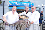 Liam Quinlan, Paul Stack and Fintan Quinlan holding a freshly caught Monkfish outside their new premises in Deerpark, Killarney.