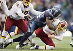 Washington Redskins quarterback Rex Grossman is sacked by Seattle Seahawks defensive end Anthony Hargrove in the third quarter at  CenturyLink Field in Seattle, Washington on November 27, 2011.   Redskins stunned the Seattle Seahawks 23-17. ©2011 Jim Bryant Photo. All Rights Reserved.