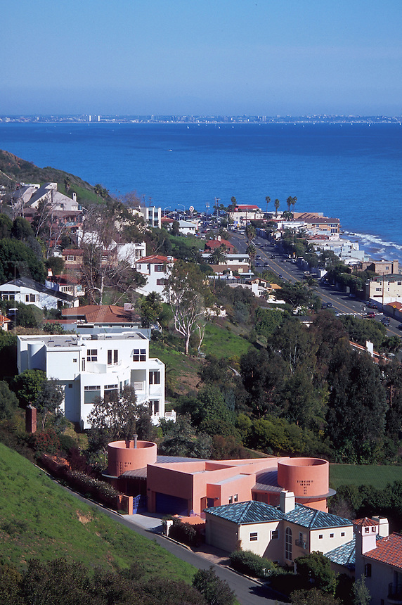 Malibu coastal community homes on a hillside overlooking the Pacific Ocean coastline. California.
