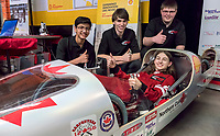 "Northern Collegiate's Team Northern had ""The Rover"", a fuel efficient vehicle, on display for the final, home game of the Sarnia Sting. The display attracted a steady crowd of young and old to view the hand crafted vehicle and quiz enthusiastic team members. A highly modified and finely tuned  one cylinder engine propels the vehicle around a race track for 10 laps. Driver and a team manager Maria Peregoudov says the competition is based on efficiency not speed. Last year that worked out to be 422 miles per gallon of fuel placing it 23rd out of 44 teams in the gasoline prototype division. It is the only high school team that will compete at the Shell Eco-marathon Americas in Sonoma, California (April 19-22). Team representatives are; driver Maria Peregoudov, and from left; Devarsh Shah, Nathaniel Smith and Jared Waller."