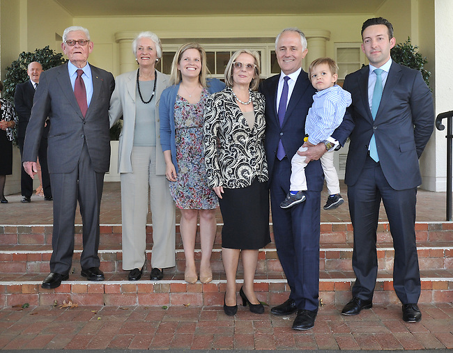 Australian Prime Minister Malcolm Turnbull (3R) stands with family members, parents in law Tom (L) and Christine Hughes (2L), daughter Daisy (3L) wife Lucy (C) grandson Jack (2R) and his son in law James Brown (R) at Government House, Canberra on September 15, 2015. Photographer: Mark Graham/Bloomberg