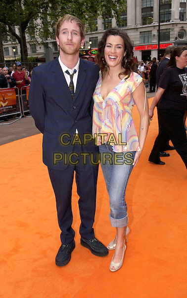 """PAUL KAYE & KATE MAGOWAN.UK Premiere of """"It's All Gone Pete Tong"""",.Empire Leicester Square, London, May 26th 2005..full length matthew williamson stars rainbow patterned top.Ref: DH.www.capitalpictures.com.sales@capitalpictures.com.©David Hitchens/Capital Pictures."""