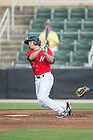 Ryan Leonards (13) of the Kannapolis Intimidators follows through on his swing against the Lexington Legends at CMC-Northeast Stadium on May 26, 2015 in Kannapolis, North Carolina.  The Intimidators defeated the Legends 4-1.  (Brian Westerholt/Four Seam Images)